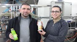 شركة العصير الفلسطينية 'أرضي' تدخل في منافسة مع رائد محليّ